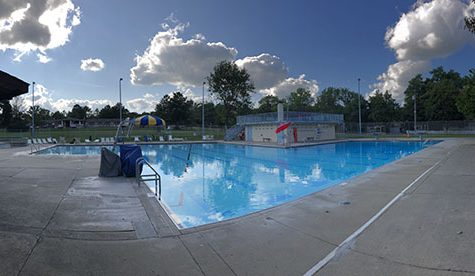 The Oxford pool reflects a cloudy sky on Aug. 31, three days before it will close forever. <em>Photo by Alex MacGregor.</em>