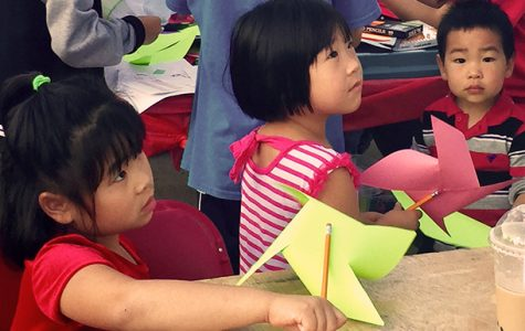 Children with pinwheels made at one of many craft booths at the Chinese Festival. <em>Photo by Olivia Lewis</em><br>