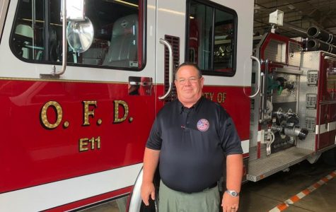 Oxford Fire Chief John Detherage, standing in front of one of the department's trucks, said there is an upsurge of alcohol-related emergency calls at the beginning of every school year. <em>Photo by Emily Goliver</em><br>