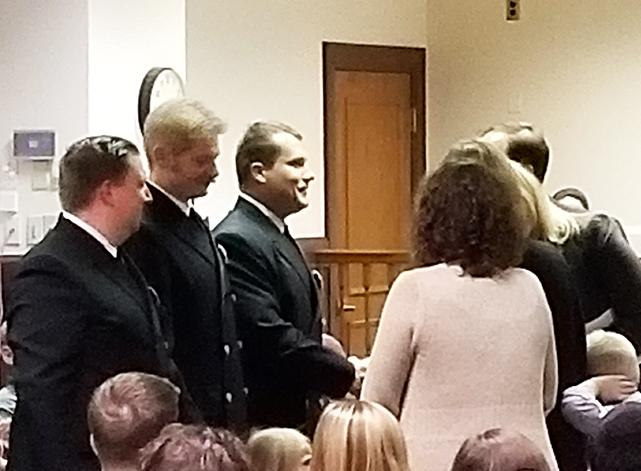 From left to right, Thom Radomski-Bomba, Jared Baker and Blake Olson are sworn in Tuesday as full-time firefighters for the City of Oxford. Photo by Brady Easterling