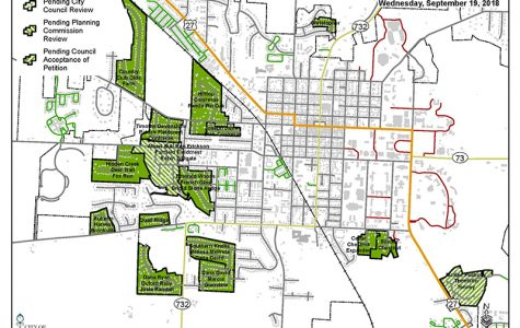 The areas shaded in green represent the existing overlay districts in Oxford. The green striped area along Route 27 in the lower right corner of the map is the Juniper Hill subdivision, now being considered for an overlay designation.
