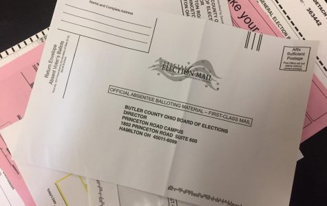 New envelopes designed to better fit absentee ballots require more postage than a single stamp. The Board of Elections says it will pay the postage due. <em>Photo by David Wells</em>