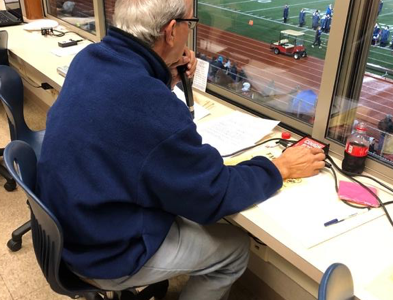 Joe Pyfrin calls a game during his 43rd season as the announcer for the Talawanda High School football team. <em>Photo by Halie Barger</em><br>