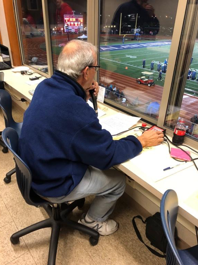 Joe Pyfrin calls a game during his 43rd season as the announcer for the Talawanda High School football team. Photo by Halie Barger