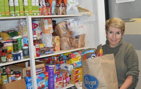 Susan Hurst stocks the basement shelves in her Oxford home with groceries purchased with her canny couponing. Every six weeks or so she fills up her car with what she has accumulated and donates it to the Oxford Community Choice Pantry. <em>Photo by Rachel Berry</em><br>