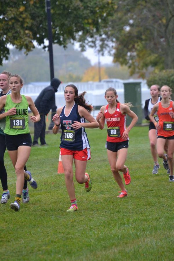 Maddy Iden, in dark jersey, sticks with the pack at the OHSAA Troy Regional Cross Country Meet on Oct. 27. Photo courtesy of Danielle Chaney