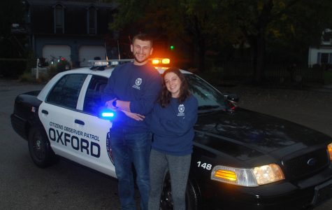 C.J. Yarworth and Hannah Elias are student volunteers on Oxford's Citizens Observer Patrol.<em> Photo provided by the Citizens Observer Patrol</em>