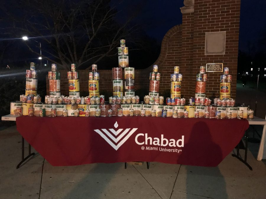 "A ""CANorah"" made of donated canned goods was erected during the Hanukkah celebration. The food later was donated to the food pantry. Photo by Katie Giles"