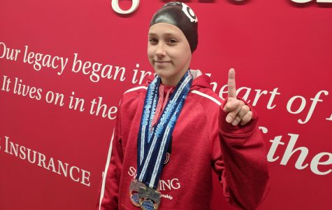 Anna Gregg on the victory stand early in January at the Mid-State All Star Swim Meet in Indianapolis. <em>Photo courtesy of Lindsay Gregg</em><br>