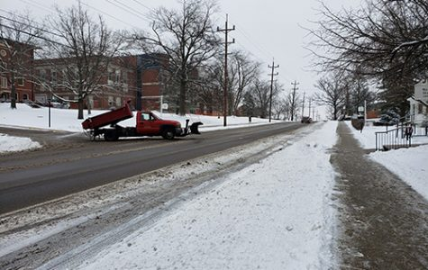 Snow overnight on Thursday caused a two-hour delay for the start of classes at Miami on Friday while salt trucks such as this one on Spring Street treated the roads. <em>Photo by Ben Corwin</em><br>