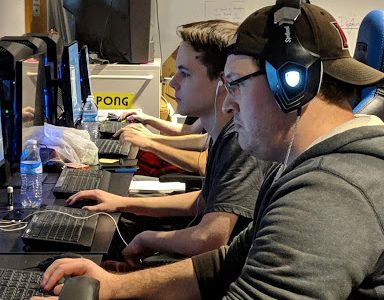 Cameron Foister and Luke Cunningham are in the zone finishing coding their game Gargoyle Condo with just 15 hours left.<em> Photo by Rebecca Huff</em>