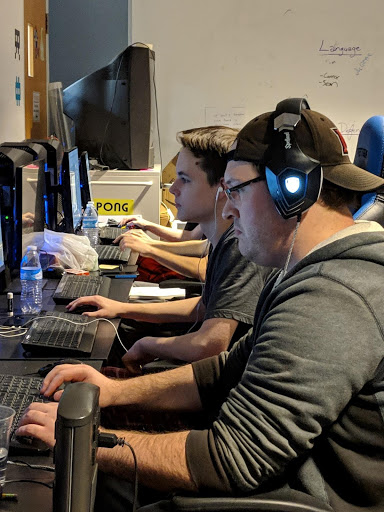 Cameron Foister and Luke Cunningham are in the zone finishing coding their game Gargoyle Condo with just 15 hours left. Photo by Rebecca Huff