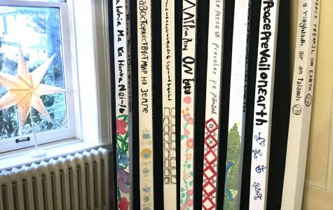 Peace poles produced by the Talawanda Middle School Art Club on display at the Oxford Community Arts Center. <em>Photo by Caroline Roethlisberger</em>