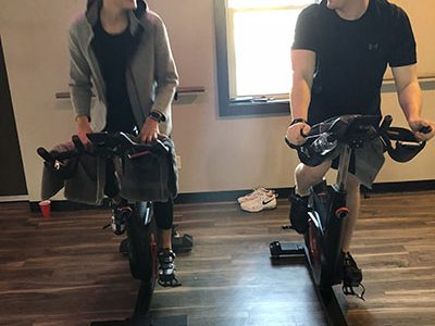 <strong> </strong>Jeffrey Plotka and Gaby Meissner work out on stationary bikes at Royal 24. <em>Photo by Patrick Donovan</em>