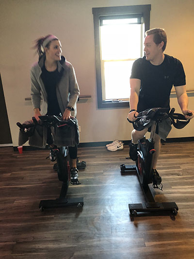 Jeffrey Plotka and Gaby Meissner work out on stationary bikes at Royal 24. Photo by Patrick Donovan