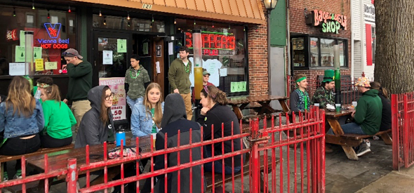 "Skipper's Bar and Pub is full of Green Beer Day celebrants Thursday about 3:30 p.m., enjoying ""green beer towers"" (far right) in honor of the town celebration. Photo by Leanne Stahulak"