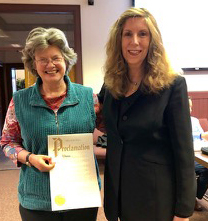 Oxford Mayor Kate Rousmaniere (left) presents Sibyl Harris Miller with a City of Oxford proclamation honoring her decades of civic action. <em>Photo courtesy of the League of Women Voters of Oxford</em><br><br>