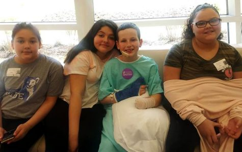 Caleb Bogan with members of his family, (left to right) sister Kaylin Bogan, cousin Ciarra, Caleb, and his cousin Adreyonna, shortly before going home from the hospital. <em>Photo provided by the family</em>