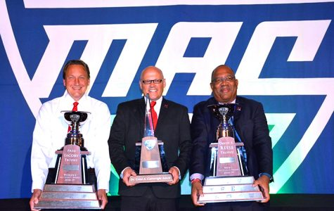 At the MAC trophy presentation in Cleveland on Wednesday, from left to right, Miami Athletic Director David Sayler holds the Jacoby Trophy; President Gregory Crawford holds the Cartwright Award, presented by the Mid-American Conference for excellence in academics, athletics and citizenship; and Ronald Scott, faculty athletic representative, holds the Reese Trophy. <em>Photo courtesy of Miami Athletics.</em><br>