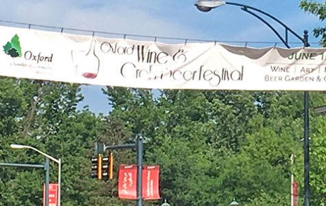 A banner over High Street at Campus Avenue touts the 12th Annual Oxford Wine & Craft Beer Festival being held this Saturday. <em>Photo by Aaron Smith.</em><br>