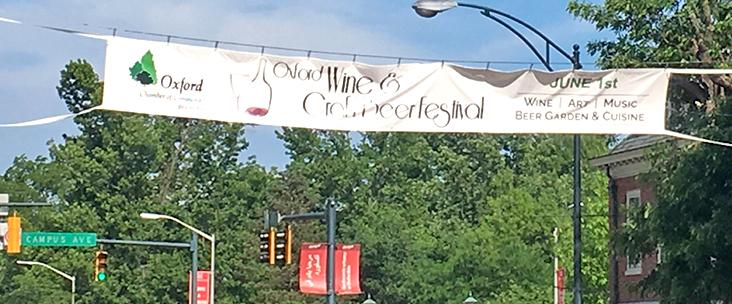 A banner over High Street at Campus Avenue touts the 12th Annual Oxford Wine & Craft Beer Festival being held this Saturday. Photo by Aaron Smith.