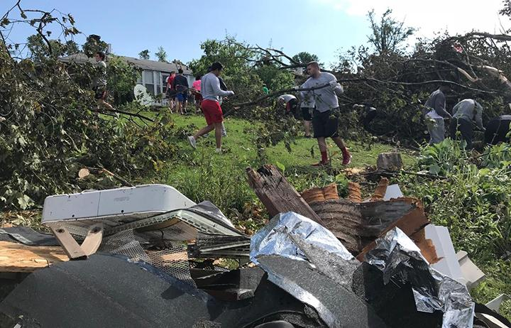 Miami+football+players+are+able+to+move+heavy+branches+with+a+lot+more+ease+than+most+people%2C+cleanup+supervisors+noted+on+Friday.+Photo+by+Chris+Vinel