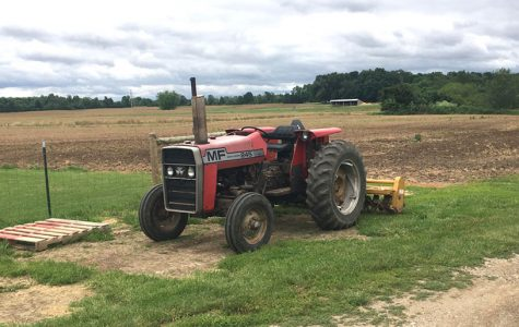 Until the fields dry out, Michael Schwab's tractor will continue to sit idle at his Oxford farm. <em>Photo by Aaron Smith</em><br>