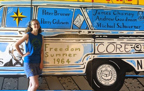 Talawanda senior, Ella Cope finishes her civil rights mural commemorating martyred civil rights workers trained in Oxford during the Freedom Summer of 1964. The mural will be mounted on the side of an uptown building Friday evening. <em>Photo by Rebecca Huff</em>