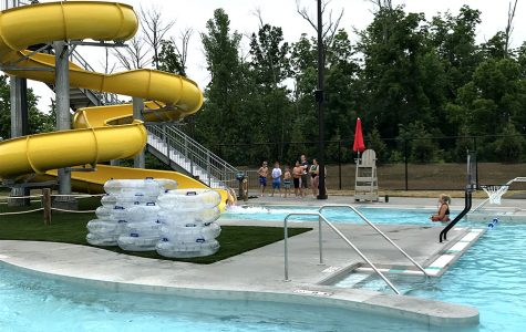 Colorful water slides are expected to be popular features at the pool. <em>Photo by Chris Vinel</em><br>