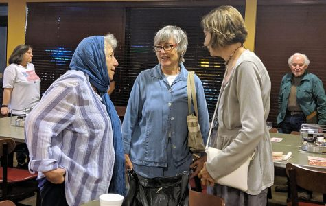 Mary Rezaian, Patricia Klingenber, vice president of the Butler County Progressives Political Action Committee, and Judy Kolbas enjoy conversation at the watch party. <em>Photo by Rebecca Huff</em><br>