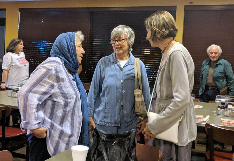 Mary Rezaian, Patricia Klingenber, vice president of the Butler County Progressives Political Action Committee, and Judy Kolbas enjoy conversation at the watch party. Photo by Rebecca Huff