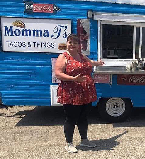 Theresa Martinez in front of her Momma T's Tacos and Things, where she serves 400 tacos a day from her mobile food wagon. Photo courtesy of Theresa Martinez