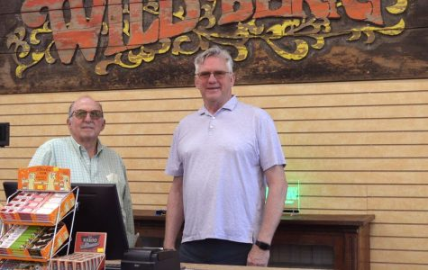 Wild Berry business owners Marc Biales (left) and Roger Atkin stand behind the counter in their new factory incense store. Photo provided by Wild Berry