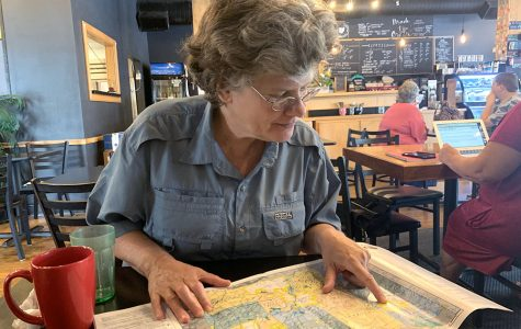 Mayor Kate Rousmaniere goes over a map of Butler County, during a recent interview in the Kofeyna coffee shop on High Street. Photo by Ryan McSheffrey
