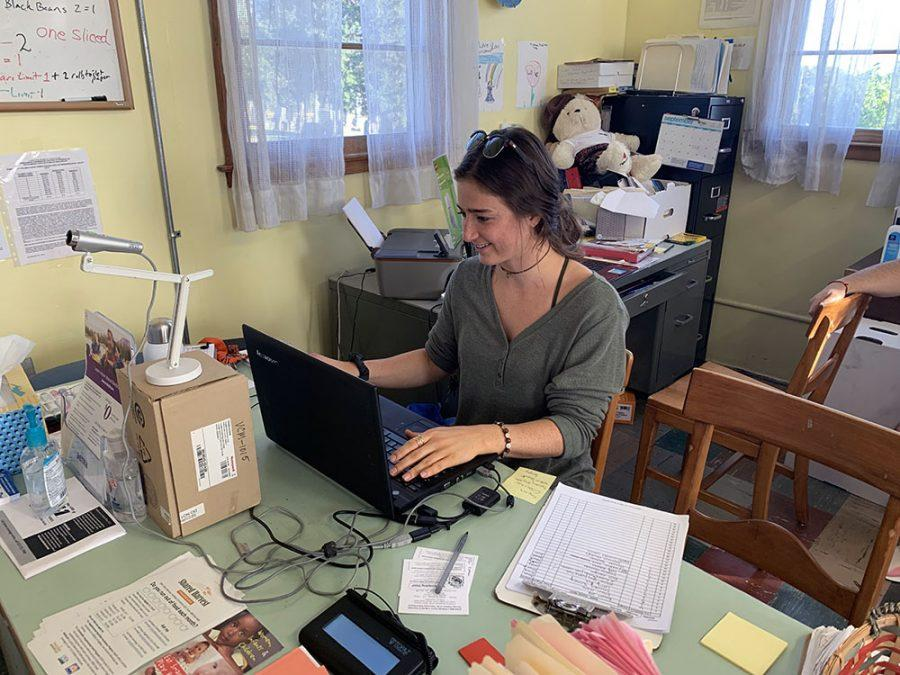 Ali vonErden, a junior dietetics major at Miami University, takes a shift as a receptionist and shopping assistant Thursday at the Talawanda Oxford Pantry and Social Services (TOPSS). Photo by Mallory Hackett