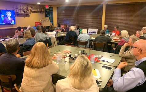 More than 40 people gathered to watch the debate on television, on at the LaRosa's in Oxford. Audience members showed their support for individual candidates as they came on screen, such as the woman in the front row waving a sign for Amy Klobuchar. <em>Photo by Josiah Collins</em><br>