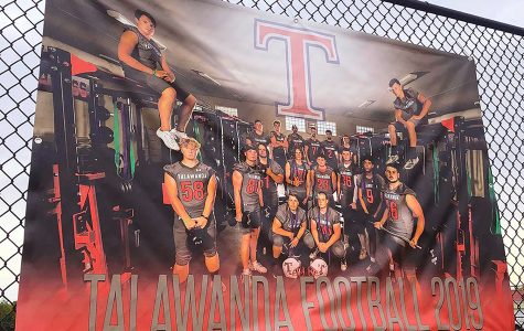 A banner showing layers on this year's Talawanda football team in the high school weight room.<em> Photo by Massillon Myers</em>