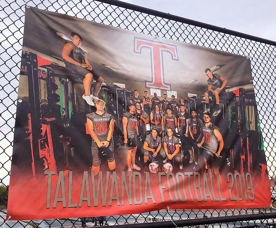 A banner showing layers on this year's Talawanda football team in the high school weight room. Photo by Massillon Myers