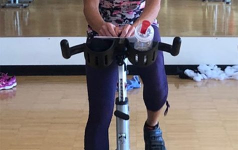 Kelly Halderman keeps up a running commentator as she leads a spinning class at the Miami Rec Center. <em>Photo by Patrick Donovan</em>