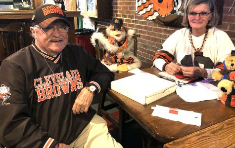 Jim and Geri Schick, pictured with J.J., their lucky charm stuffed animal, have been Browns Backers members since its inception in 1999. Jim now serves as the president of the club. <em>Photo by Massillon Myers</em>