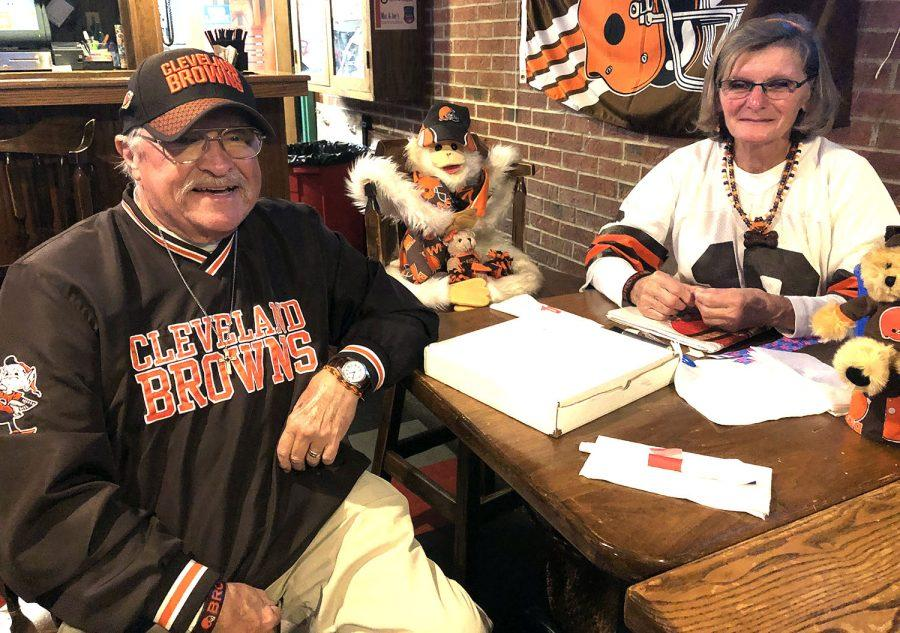 Jim and Geri Schick, pictured with J.J., their lucky charm stuffed animal, have been Browns Backers members since its inception in 1999. Jim now serves as the president of the club. Photo by Massillon Myers