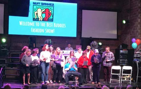 Members of Miami's chapter of Best Buddies perform a song for the audience at the end of Sunday's fashion show and karaoke at the Brick Street Bar on Sunday. <em>Photo by Yumeng Shen.</em><br>