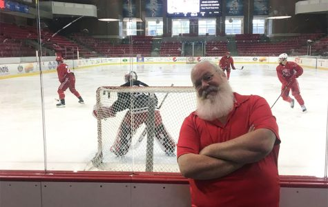 Scott Shriver, who looks a lot like Santa Claus, has been announcing Miami's ice hockey games for 24 years. <em>Photo by Matt Wininger</em>