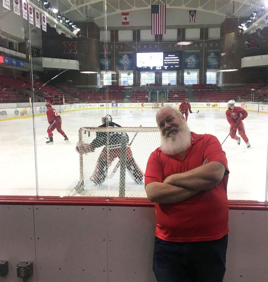 Scott+Shriver%2C+who+looks+a+lot+like+Santa+Claus%2C+has+been+announcing+Miami%E2%80%99s+ice+hockey+games+for+24+years.+%3Cem%3EPhoto+by+Matt+Wininger%3C%2Fem%3E