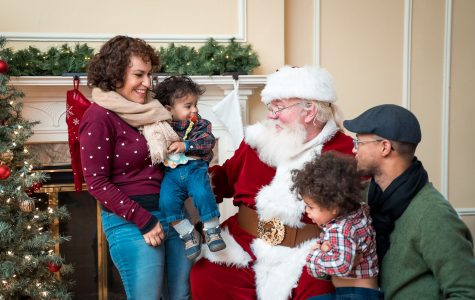 Santa Claus was available for pictures and wish lists last year. He will be back this year, at the Oxford Community Arts Center from noon to 2 p.m.; when he arrives at the park pavilion on a fire truck at 6:30 p.m.; and for more photos and lap sitting from 6:30 p.m. to 8 p.m., on his throne in the Enjoy Oxford office, 14 W. Park Place, suite C. <em>Photo provided by Enjoy Oxford.</em>