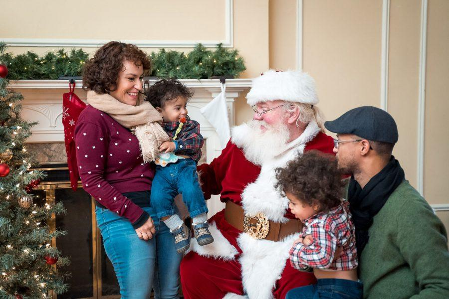 Santa Claus was available for pictures and wish lists last year. He will be back this year, at the Oxford Community Arts Center from noon to 2 p.m.; when he arrives at the park pavilion on a fire truck at 6:30 p.m.; and for more photos and lap sitting from 6:30 p.m. to 8 p.m., on his throne in the Enjoy Oxford office, 14 W. Park Place, suite C. Photo provided by Enjoy Oxford.