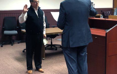 <strong> </strong>Oxford Mayor Mike Smith, left, takes the oath of office Tuesday night from the city's law director, Christopher Conard. <em>Photo by Halie Barger</em>