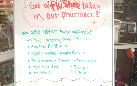 The CVS on W. Spring Street reminds customers in English, Spanish and Mandarin that it is not too late to get a flu shot. <em>Photo by Mallory Hackett</em>