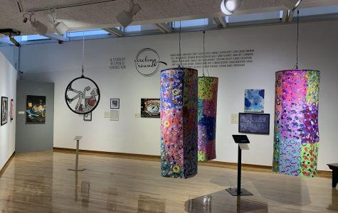 Visitors are asked to vote at the kiosk on their favorite pieces with the top three winning a cash reward. <em>Photo by Emma Hendy</em>