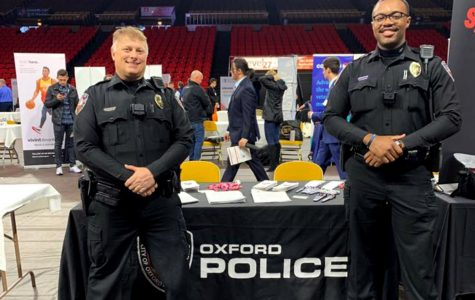 Officers Pete Durkin and Anthony Jones worked the Oxford Police Department table at Miami's Spring Career and Internship Fair on Wednesday in Millett Hall. The police department was one of a handful of local employers among the 250 at the fair. OPD has two open positions for police officers at the moment according to its Facebook page. <em>Photo by the Oxford Police Department. </em>